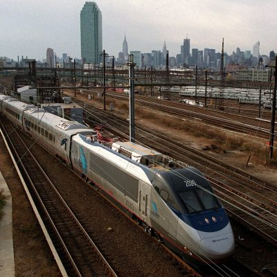 NEW YORK, UNITED STATES:  Amtrak's new Acela Express train is seen against the Manhattan skyline as it heads to Boston, 16 November 2000. The train rode from Washington DC to New York to Boston, with regular service expected to begin 11 December. The Acela Express is the first high-speed rail service in North America, moving across the Northeast at a top speed of 150 mph. (FILM) AFP PHOTO Doug KANTER (Photo credit should read DOUG KANTER/AFP/Getty Images)