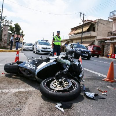 Argolida Greece - May 15 2016: traffic accident between a car and a motorcycle large displacement on country roads